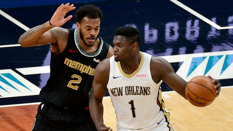 New Orleans Pelicans forward Zion Williamson (1) is defended by Memphis Grizzlies center Xavier Tillman (2) during the first half of an NBA basketball game Tuesday, Feb. 16, 2021, in Memphis, Tenn.