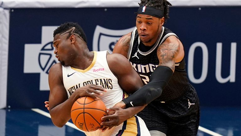 New Orleans Pelicans forward Zion Williamson, left, is fouled by Sacramento Kings center Richaun Holmes in the first half of an NBA basketball game in New Orleans, Monday, Feb. 1, 2021.