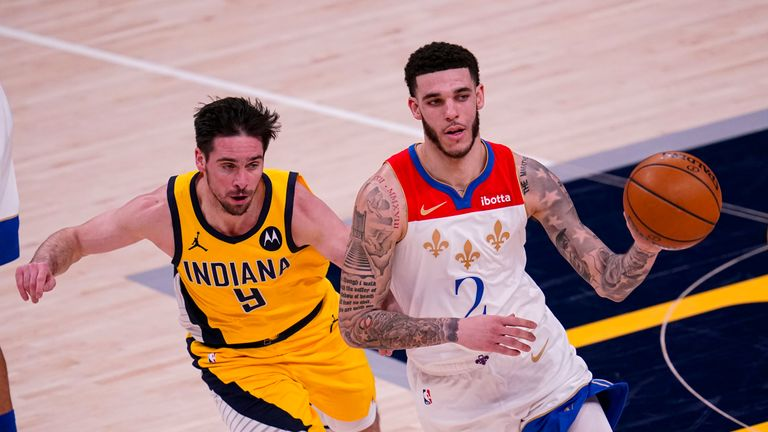 New Orleans Pelicans guard Lonzo Ball (2) drives past Indiana Pacers guard T.J. McConnell (9) during the second half of an NBA basketball game in Indianapolis, Friday, Feb. 5, 2021. The Pelicans defeated the Pacers 114-113. (AP Photo/Michael Conroy)