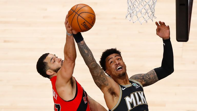 Toronto Raptors guard Fred VanVleet (23) goes up for a shot as Atlanta Hawks forward John Collins (20) defends during the first half of an NBA basketball game Saturday, Feb. 6, 2021, in Atlanta. (AP Photo/Todd Kirkland)