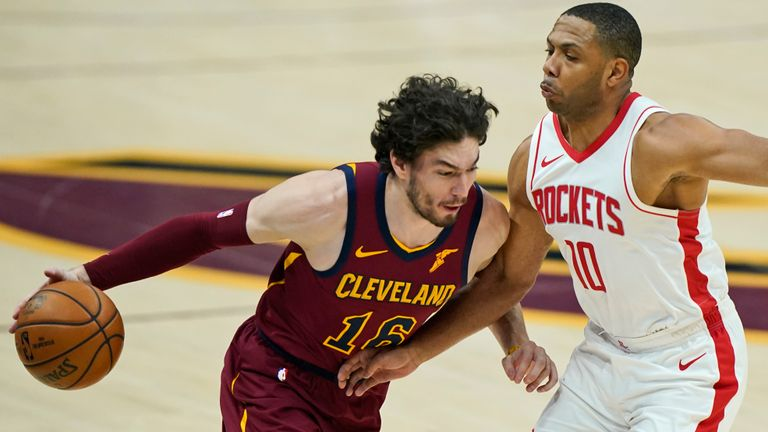 Cleveland Cavaliers' Cedi Osman (16) drives against Houston Rockets' Eric Gordon (10) in the first half of an NBA basketball game, Wednesday, Feb. 24, 2021, in Cleveland. (AP Photo/Tony Dejak)