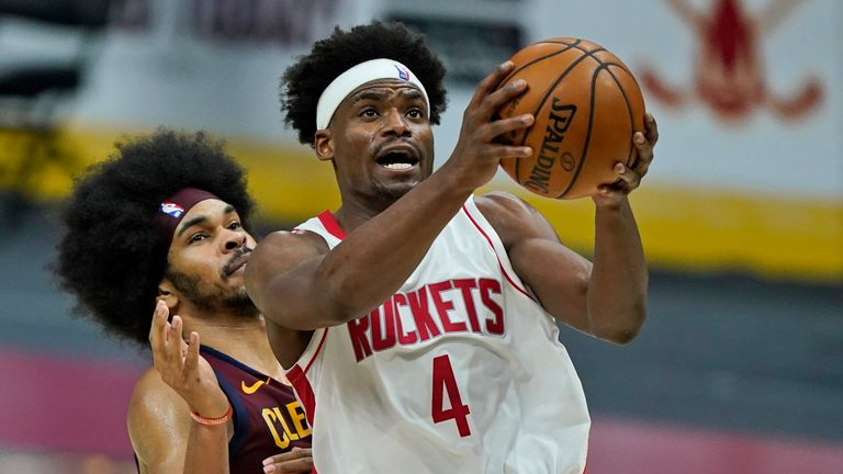 Houston Rockets' Danuel House Jr., right, drivers to the basket against Cleveland Cavaliers' Jarrett Allen in the second half of an NBA basketball game, Wednesday, Feb. 24, 2021, in Cleveland. (AP Photo/Tony Dejak)