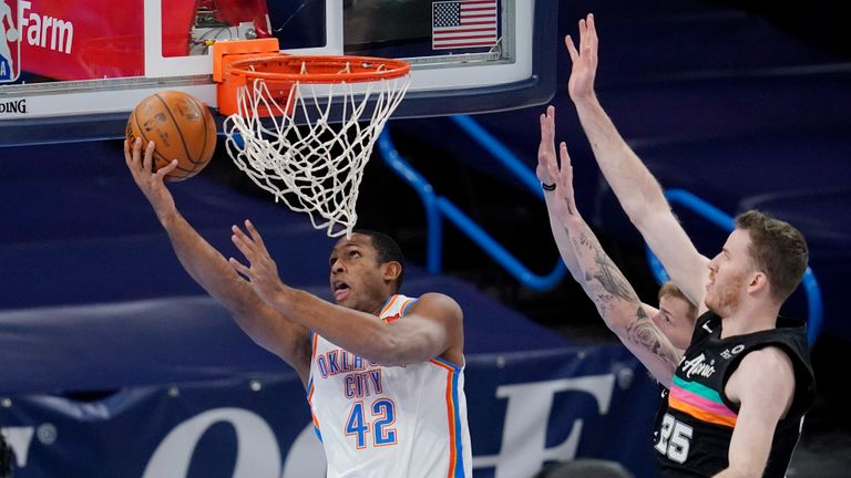 Oklahoma City Thunder center Al Horford (42) shoots in front of San Antonio Spurs center Jakob Poeltl and forward Luka Samanic, rear, during the first half of an NBA basketball game Wednesday, Feb. 24, 2021, in Oklahoma City. (AP Photo/Sue Ogrocki)