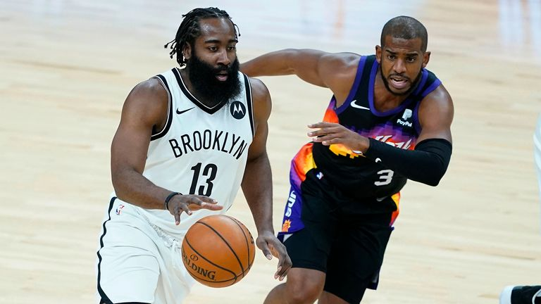 Brooklyn Nets guard James Harden (13) drives as Phoenix Suns guard Chris Paul (3) defends during the first half of an NBA basketball game Tuesday, Feb. 16, 2021, in Phoenix.