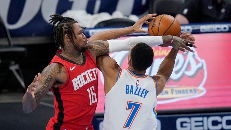 Houston Rockets guard Ben McLemore (16) fouls Oklahoma City Thunder forward Darius Bazley (7) in the second half of an NBA basketball game, Monday, Feb. 1, 2021, in Oklahoma City.