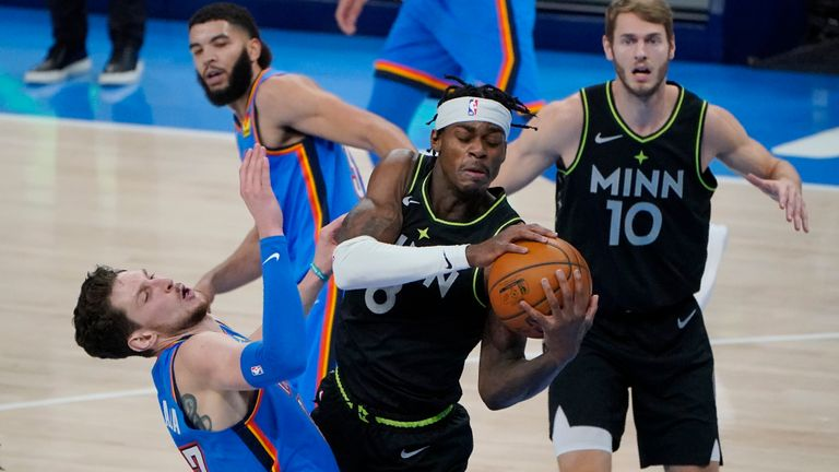 Minnesota Timberwolves forward Jarred Vanderbilt (8) grabs a rebound in front of Oklahoma City Thunder center Mike Muscala, left, during the first half of an NBA basketball game Friday, Feb. 5, 2021, in Oklahoma City. (AP Photo/Sue Ogrocki)