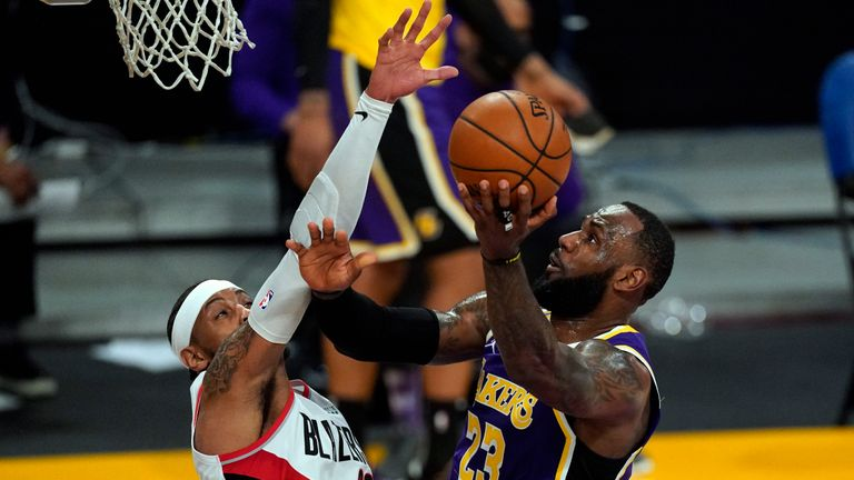 Los Angeles Lakers forward LeBron James (23) takes a shot against Portland Trail Blazers forward Carmelo Anthony (00) during the first half of an NBA basketball game Friday, Feb. 26, 2021, in Los Angeles. (AP Photo/Mark J. Terrill)