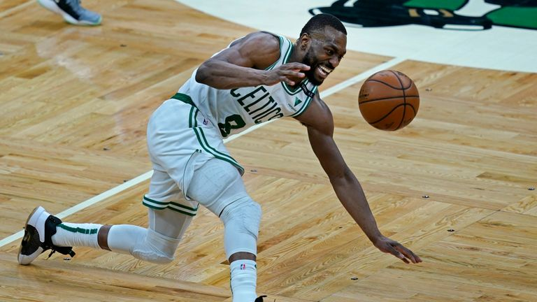 Boston Celtics guard Kemba Walker controls the ball from the floor in the fourth quarter of an NBA basketball game against the Indiana Pacers, Friday, Feb. 26, 2021, in Boston. The Celtics won 118-112. (AP Photo/Elise Amendola)