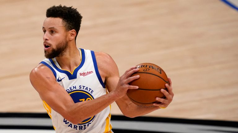 Golden State Warriors' Stephen Curry advances the ball up court in an NBA basketball game against the Dallas Mavericks in Dallas, Saturday, Feb. 6, 2021. (AP Photo/Tony Gutierrez)