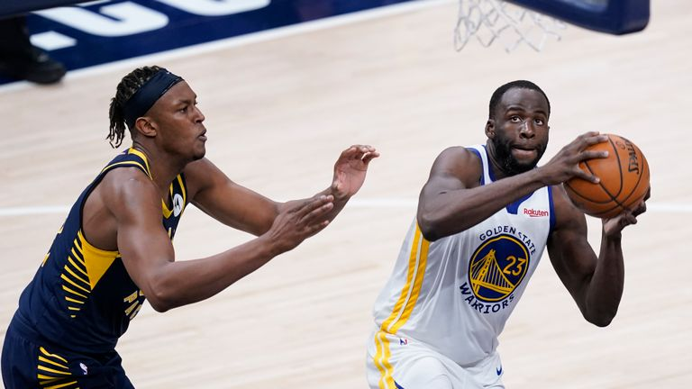 Golden State Warriors' Draymond Green (23) looks for a shot next to Indiana Pacers' Myles Turner during the second half of an NBA basketball game Wednesday, Feb. 24, 2021, in Indianapolis. (AP Photo/Darron Cummings)