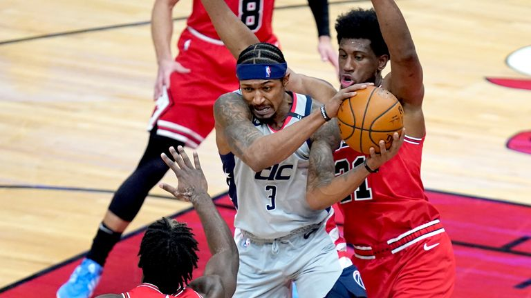 Washington Wizards' Bradley Beal (3) is forced to pass off the defense of Chicago Bulls' Thaddeus Young, right, as Patrick Williams also defends during the second half of an NBA basketball game Monday, Feb. 8, 2021, in Chicago. (AP Photo/Charles Rex Arbogast)