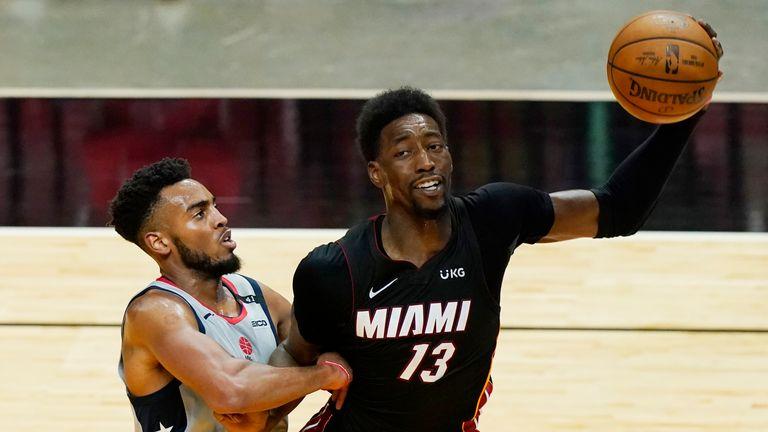 Miami Heat center Bam Adebayo (13) grabs a rebound as Washington Wizards forward Troy Brown Jr. (6) defends during the second half of an NBA basketball game, Friday, Feb. 5, 2021, in Miami. (AP Photo/Marta Lavandier)