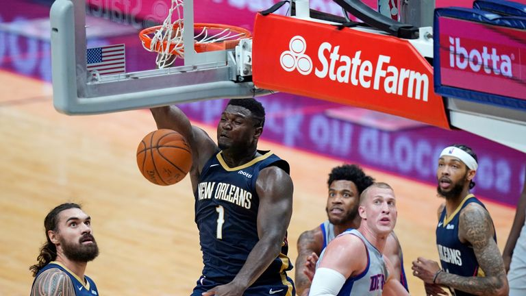 New Orleans Pelicans forward Zion Williamson (1) dunks during the second half of the team's NBA basketball game against the Detroit Pistons in New Orleans, Wednesday, Feb. 24, 2021. (AP Photo/Gerald Herbert)