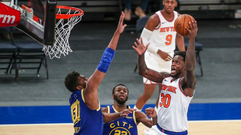 AP - New York Knicks forward Julius Randle (30) shoots against Golden State Warriors' Kevon Looney (5) and Andrew Wiggins