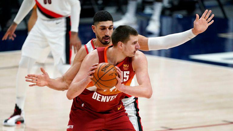 AP - Denver Nuggets center Nikola Jokic looks to pass the ball as Portland Trail Blazers center Enes Kanter