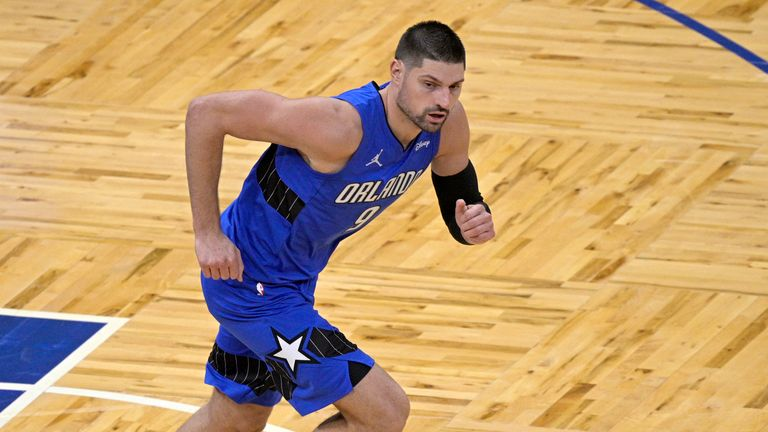Orlando Magic center Nikola Vucevic runs up the court during the first half of an NBA basketball game against the Golden State Warriors