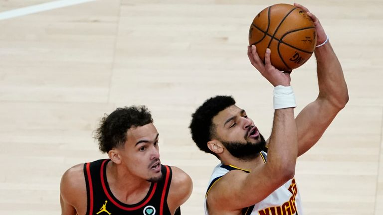 Denver Nuggets guard Jamal Murray is fouled by Atlanta Hawks guard Trae Young