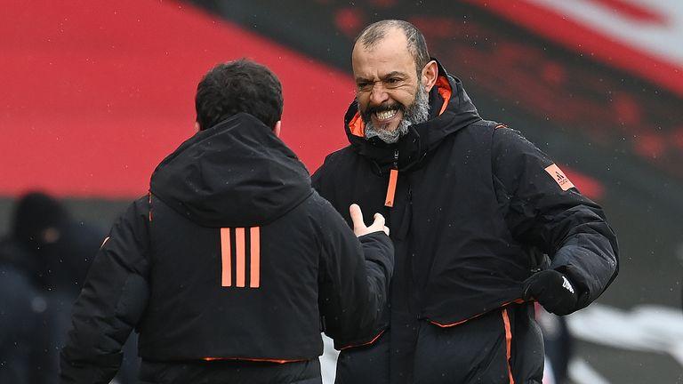 Nuno Espirito Santo celebrates with a member of his Wolves coaching staff