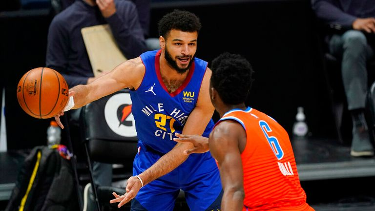 AP - Denver Nuggets guard Jamal Murray, back, passes the ball while Oklahoma City guard Thundera Hamidou Diallo