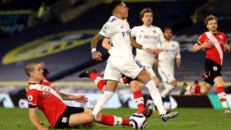 Southampton's Oriol Romeu (left) tackles Leeds United's Raphinha