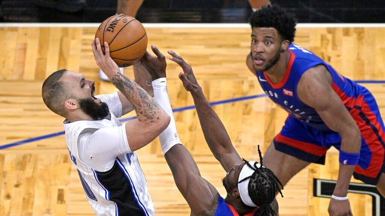 AP - Orlando Magic guard Evan Fournier, left, is fouled by Detroit Pistons forward Jerami Grant