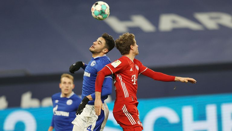 Ozan Kabak challenges Thomas Muller for the ball - AP Images