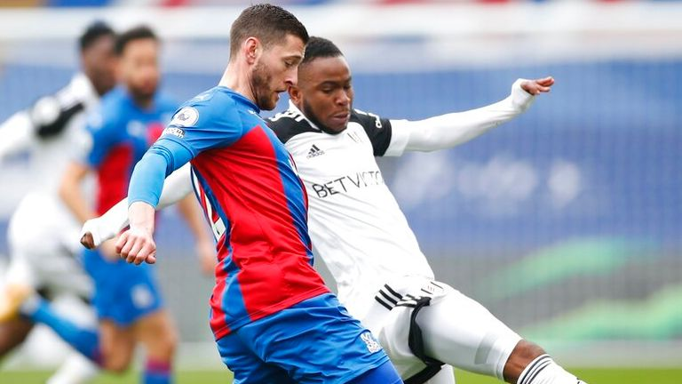 Crystal Palace's Joel Ward, left, and Fulham's Ademola Lookman challenge for the ball