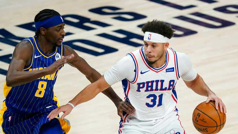 AP - Philadelphia 76ers' Seth Curry (31) is defended by Indiana Pacers' Justin Holiday (8)