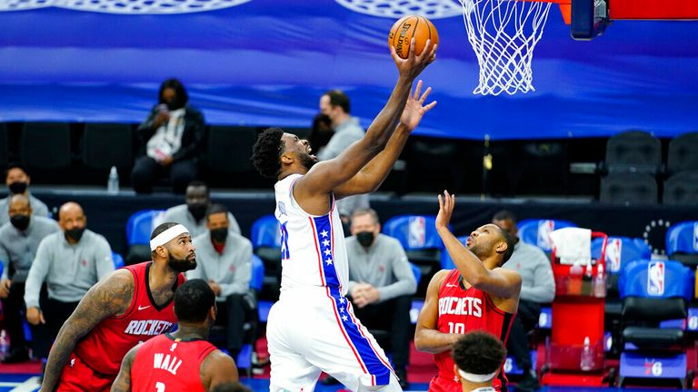AP - ' Joel Embiid, center, goes up for a shot against Houston Rockets' Eric Gordon