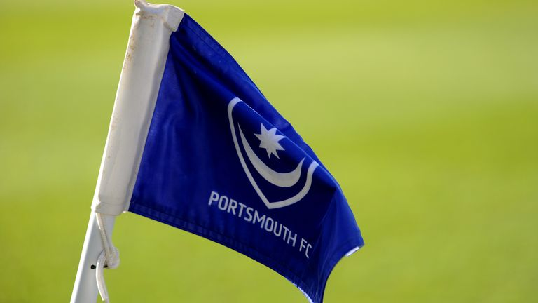 Flag bearing the club crest and logo of Portsmouth FC at Fratton Park (PA Images)