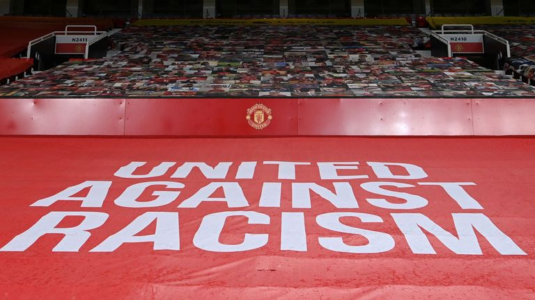 Anti-racism banner on display at Manchester United's Old Trafford stadium (PA image)