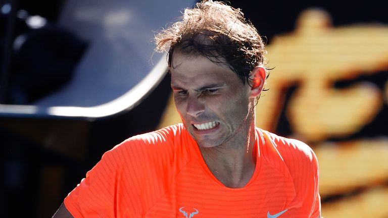Rafael Nadal allayed fears over a back problem with a straightforward opening victory at the Australian Open