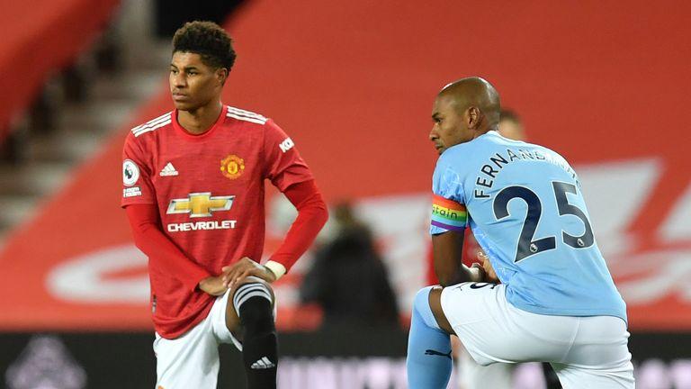 Rashford and Manchester City captain Fernandinho take a knee