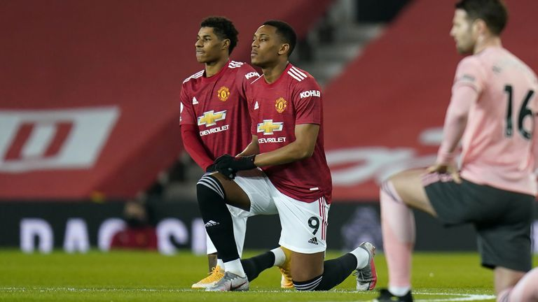 Marcus Rashford (L), Anthony Martial (C) and Manchester United team-mate Axel Tuanzebe were among the players subjected to racist abuse online last week