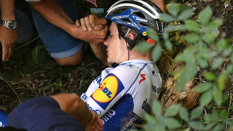Remco Evenepoel receives treatment after breaking his pelvis in a freak crash at the Giro di Lombardia last year