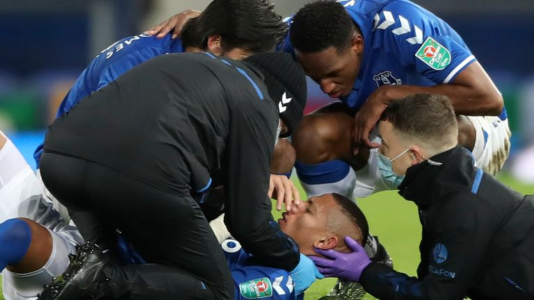 Richarlison receives attention from medical staff after a head collision