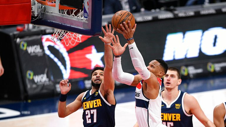 AP - Washington Wizards guard Russell Westbrook, center, goes to the basket against Denver Nuggets guard Jamal Murray