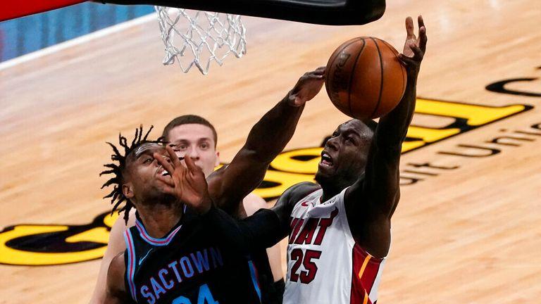 AP - Sacramento Kings guard Buddy Hield, left, blocks the shot of Miami Heat guard Kendrick Nunn