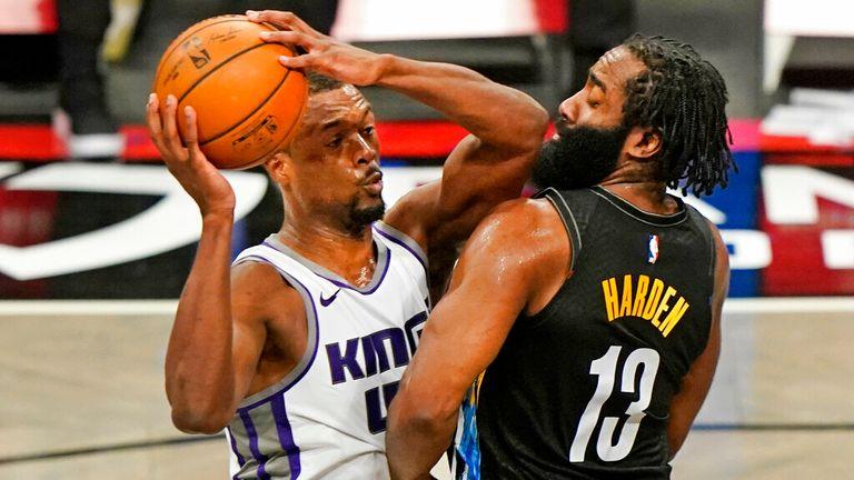 AP - Sacramento Kings forward Harrison Barnes (40) comes up against Brooklyn Nets guard James Harden (13)