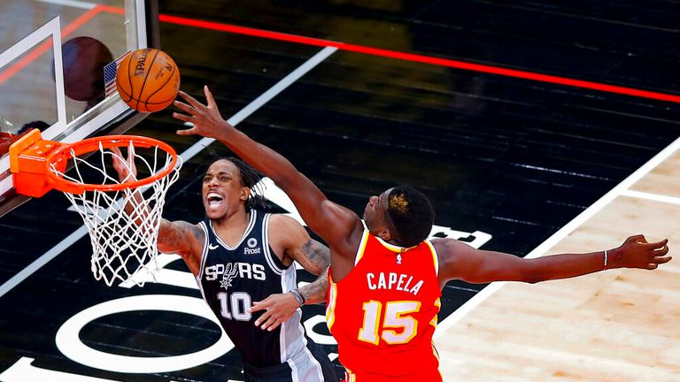 AP - San Antonio Spurs forward DeMar DeRozan (10) reacts as he is fouled by Atlanta Hawks center Clint Capela