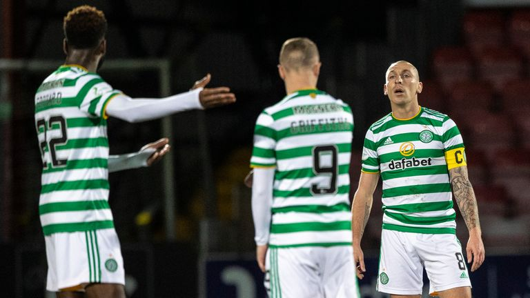 Celtic captain Scott Brown exchanges words with Odsonne Edouard during the 1-0 loss at Ross County