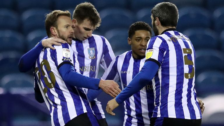 Sheffield Wednesday's Jordan Rhodes (left) celebrates his goal against Wycombe with team-mates