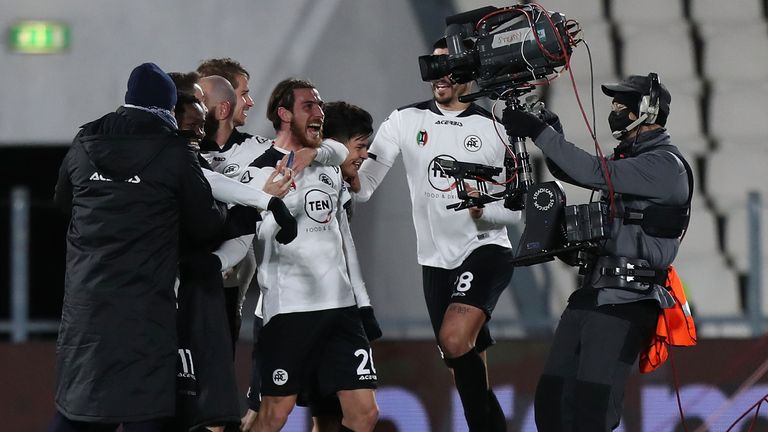 Spezia players celebrate during the victory