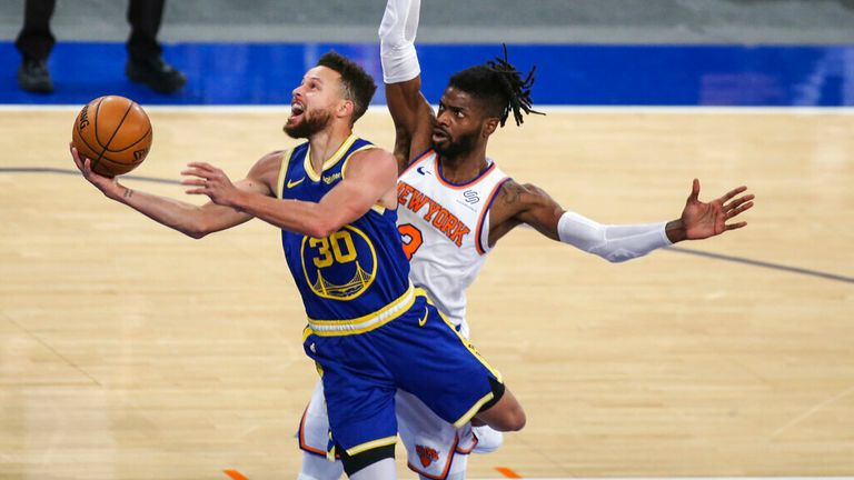 AP - Golden State Warriors guard Stephen Curry (30) moves past New York Knicks center Nerlens Noel (3)