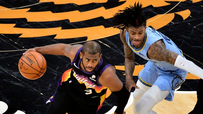 Phoenix Suns guard Chris Paul drives against Memphis Grizzlies guard Ja Morant