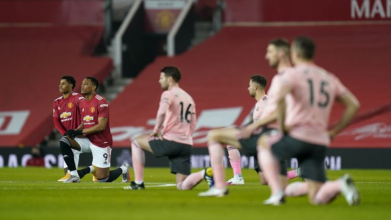 Manchester United's Marcus Rashford (left) and Anthony Martial take a knee in support of the Black Lives Matter Movement before the Premier League match at Old Trafford, Manchester. Picture date: Wednesday January 27, 2021.