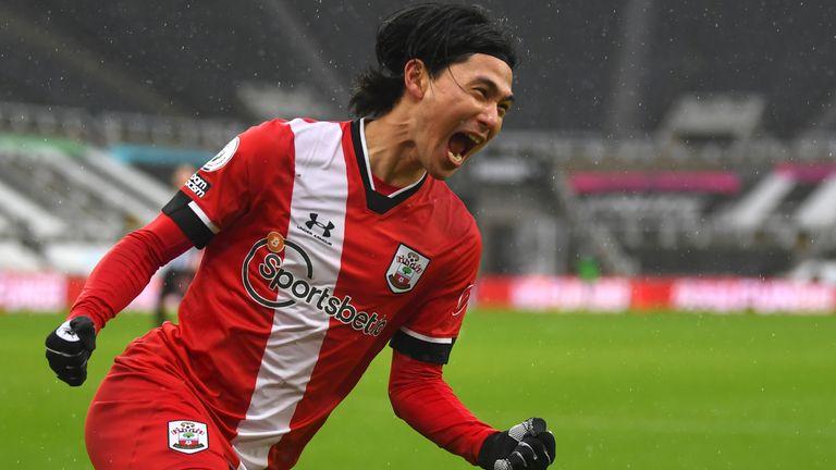 Takumi Minamino celebrates after scoring for Southampton (AP)