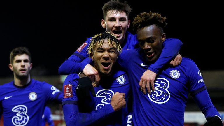 Tammy Abraham celebrates with Reece James and Billy Gilmour after scoring against Barnsley