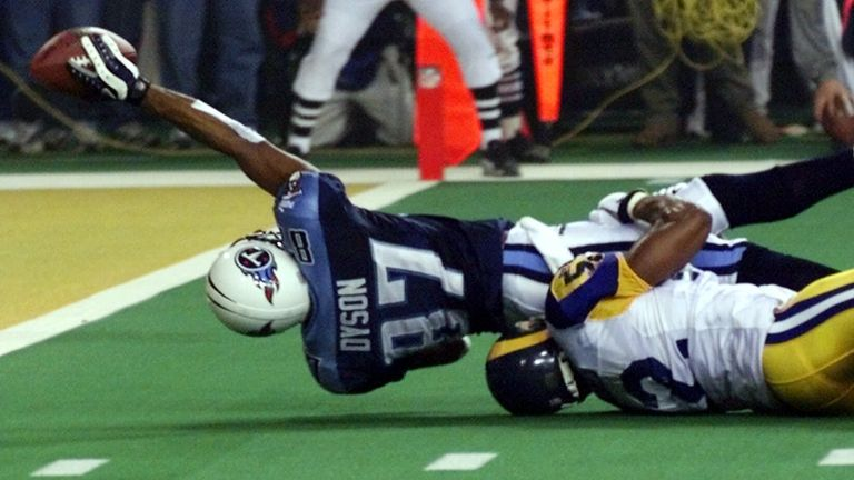 Titans receiver Kevin Dyson is tackled one-yard short of the goal line in their Super Bowl XXXIV loss to the Rams