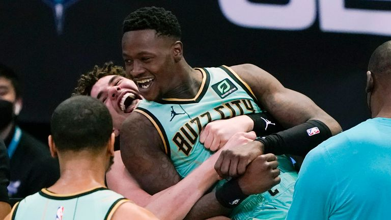 Charlotte Hornets guard Terry Rozier celebrates after scoring the game winning basket with LaMelo Ball, against the Golden State Warriors